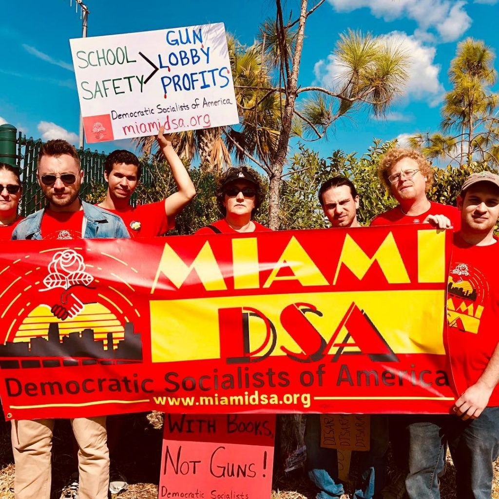 Miami DSA holding banner at March For Our Lives